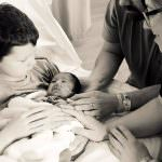 Mother and father with two sons and newborn baby