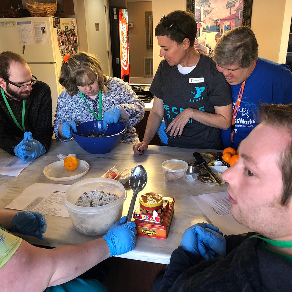 volunteers cooking in kitchen