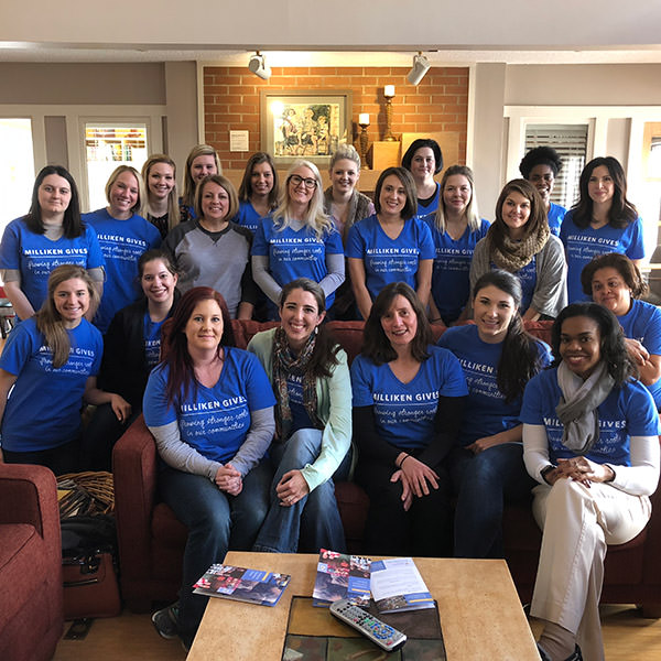 group of volunteers in house smiling