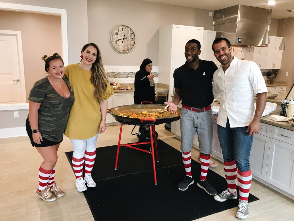 Group in RMHC kitchen wearing striped socks